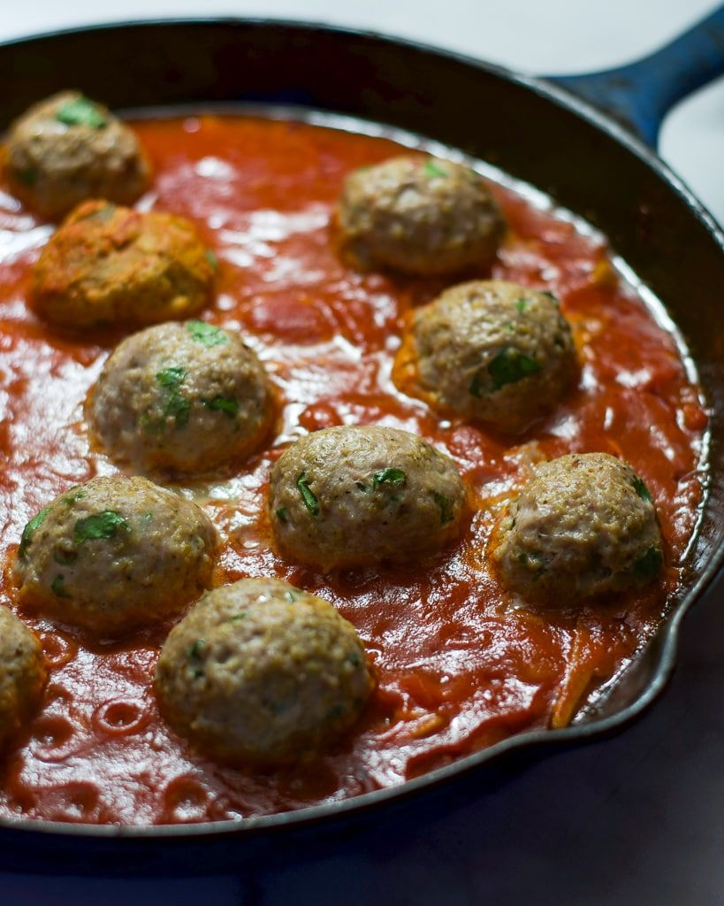 Spaghetti and Turkey Meatballs: Lightened-up turkey meatballs baked in simple homemade marinara sauce and served over spaghetti squash or pasta. An American dinner classic, my way.