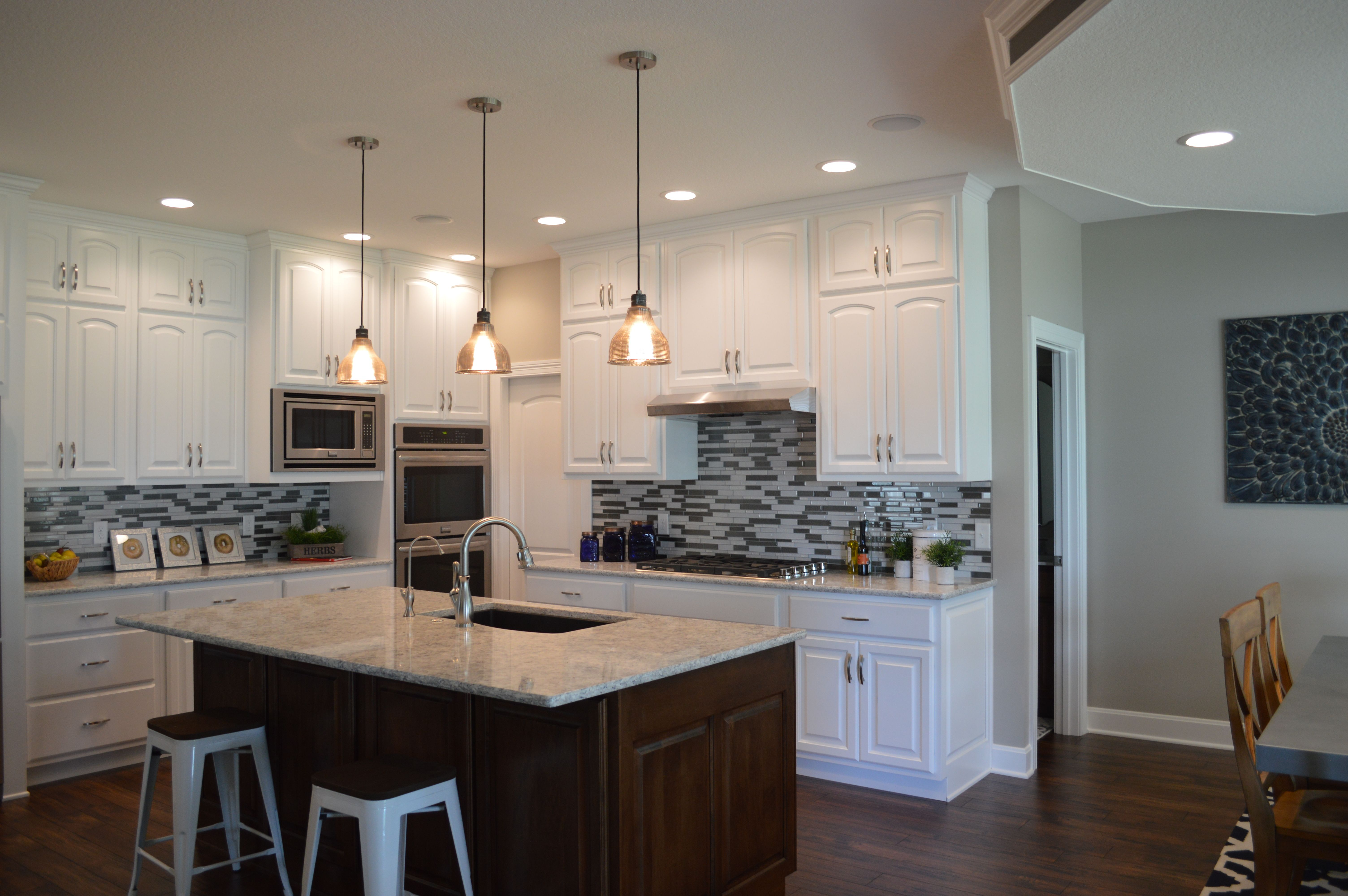 Kitchen In White And Everything Nice Painted Cabinets Light Countertops And Accent Stain Island Cabinetry Dining Nook Custom Homes Painting Cabinets