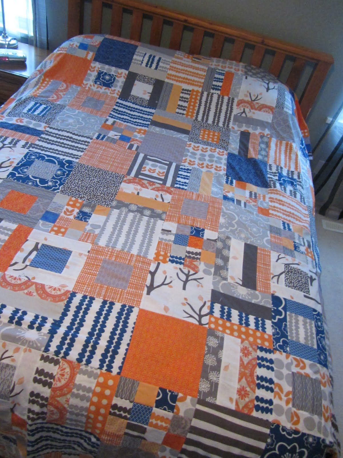 Making More With Less Orange Grey And Blue Orange Quilt Blue Quilts Modern Quilts