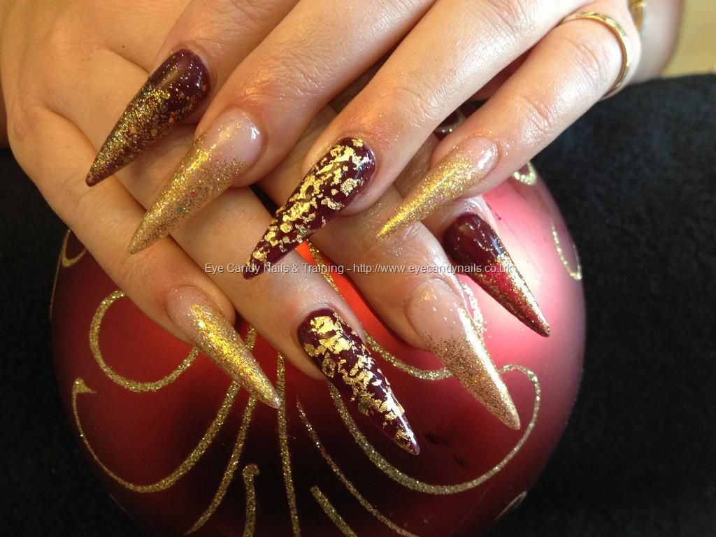 Stiletto nails with gold glitter and gold foil over deep red gel stiletto nails with gold glitter and gold foil over deep red gel polish nail designs for you prinsesfo Choice Image