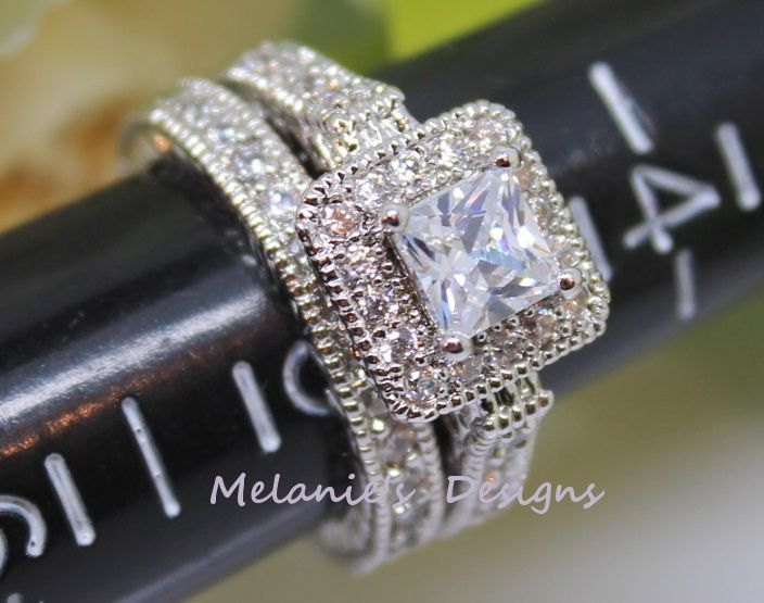 Stones : Cubic Zirconium  Color: Clear  Setting Rhodium  Main Stone :5 x 5 mm / 1 Carat  Accent Stones: 1.5 mm  Shape: Princess/ Round  Total Carats: 3.9 Carats  Ring Weight: 4.5 Grams   This ring set is Exquisite man-made cubic zirconium gemstones with the top notch workmanship shown in...