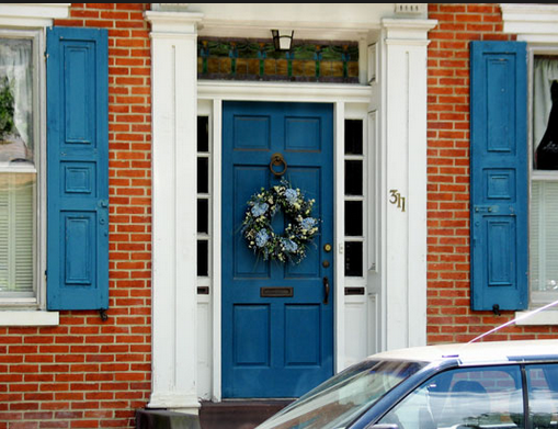 Shutters With White Trim On Brick House