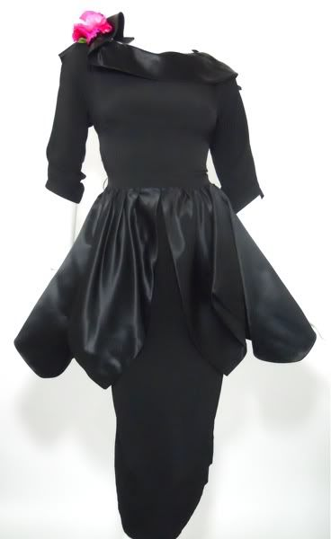 a65e8592a8d 50s dress by Minx Modes. Black crepe rayon fitted dress with dramatic petal  cut satin peplum