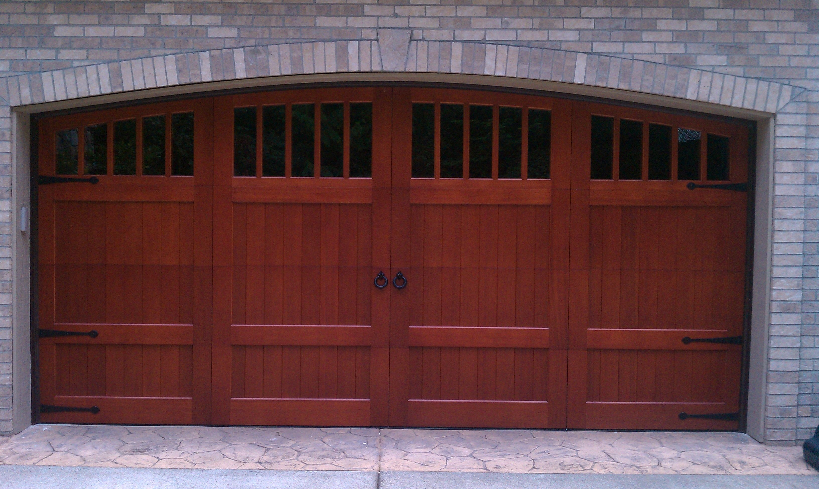 Clopay reserve collection custom wood carriage house for Buy clopay garage doors online