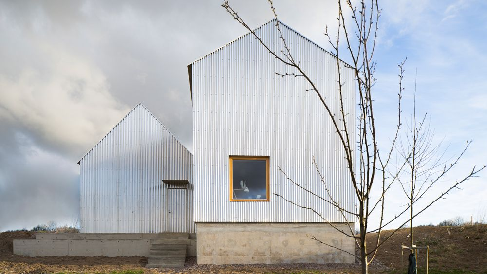 A Pair Of Gabled Buildings Clad In Corrugated Aluminium Make Up This House Linkoping Sweden Designed By Bjorn Forstberg For His Architecture House Architect