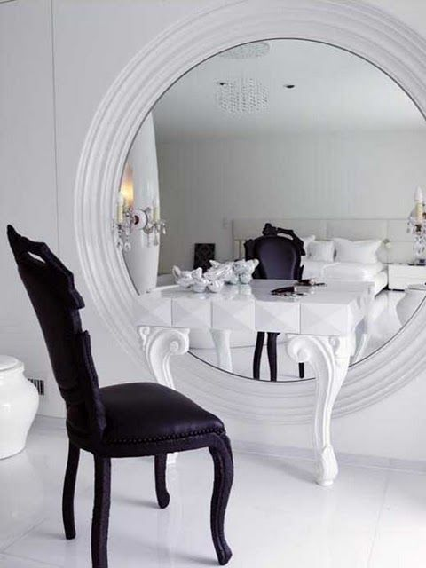 I love the huge mirror set behind the table rather than above it.