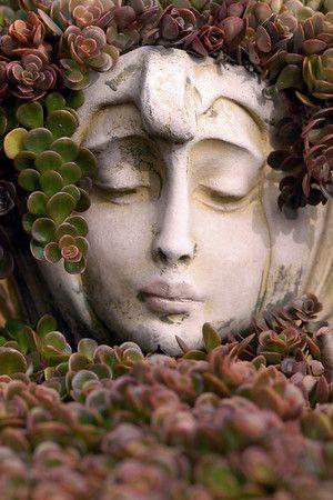 Stone Head Garden Planters   Photo By Nancy Tripp.
