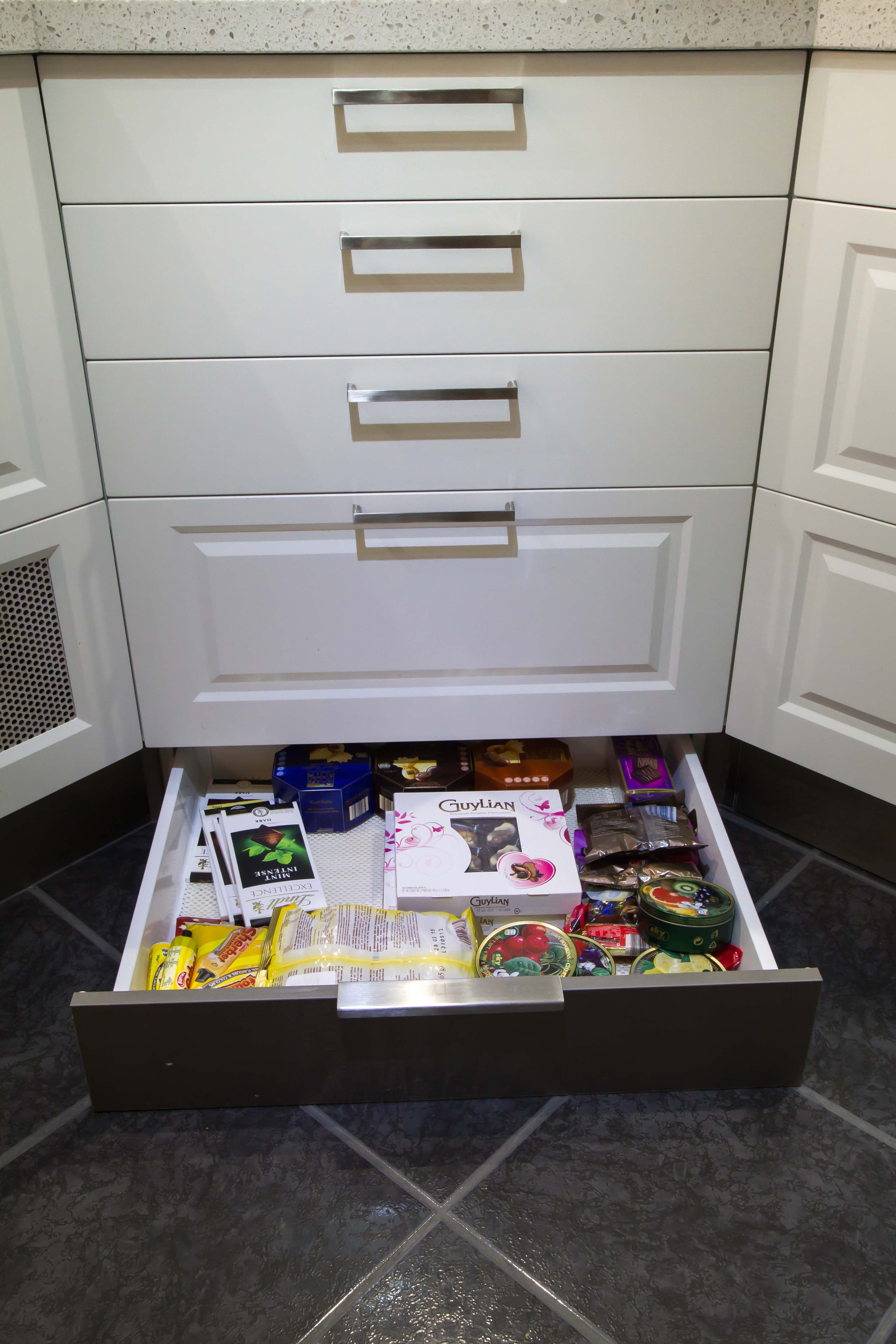Kickboard drawer allows you to hide chocolate from the kids! www.thekitchendesigncentre.com.au @thekitchen_designcentre