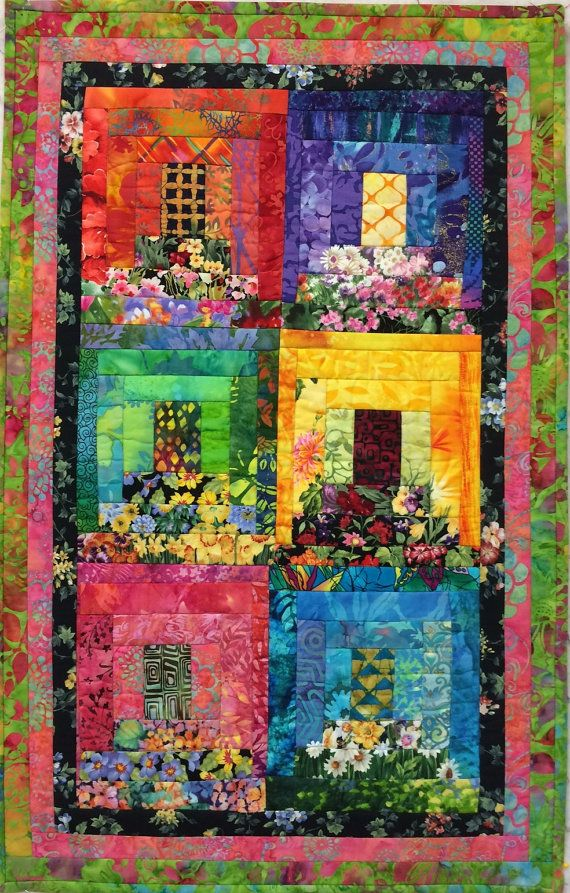 This piece was created using lots of different fabrics and my mothers design called Myras Window Boxes. Its a fun creation using floral prints to give the look of little windows with flower boxes. This piece is 29H X 18W and is sprayed with a UV protection to keep from fading. It is ready to hang with a split sleeve on the back.