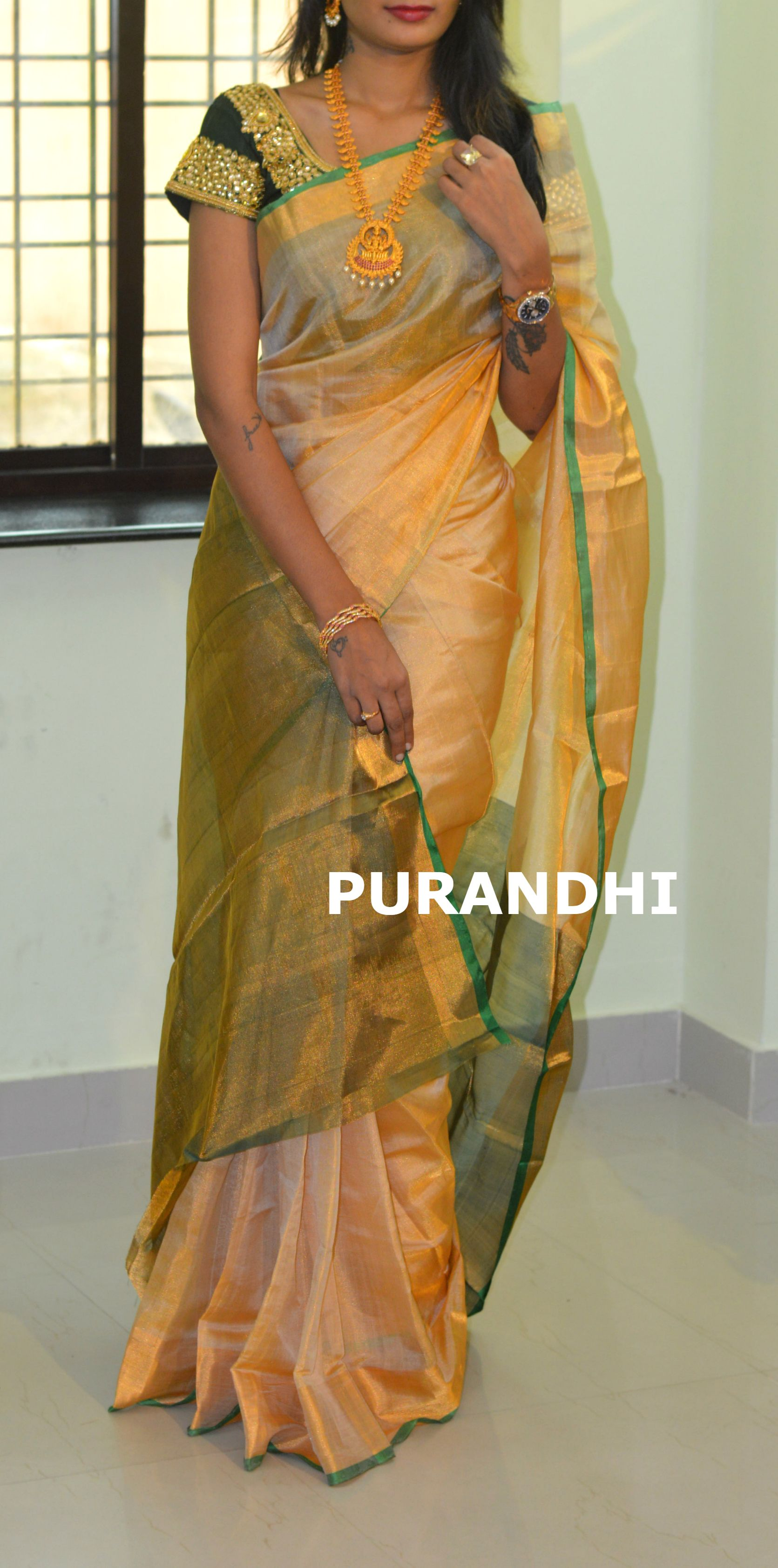 7c0ddbe6baa3a6 Cream and bottle green uppada pattu saree comes with contrast green blouse  and pallu