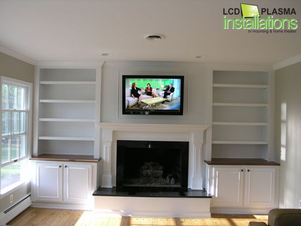 Tv Mounted Above Fireplace All Customer Cabinets And Wires Concealed Inside Wall Outlet