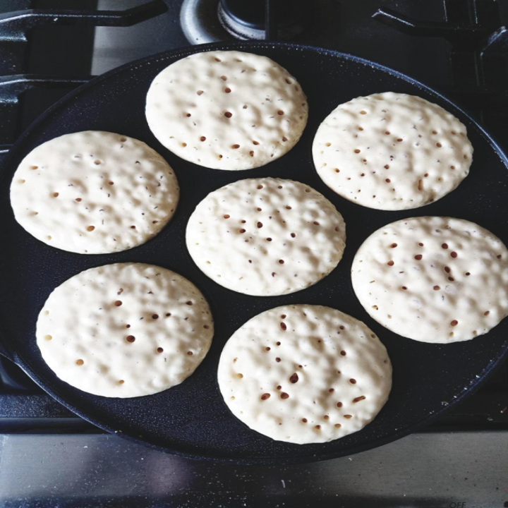 A silver dollar pancake maker that will get you *chef's kiss* perfectly crisped edges on every single one of your pancakes.