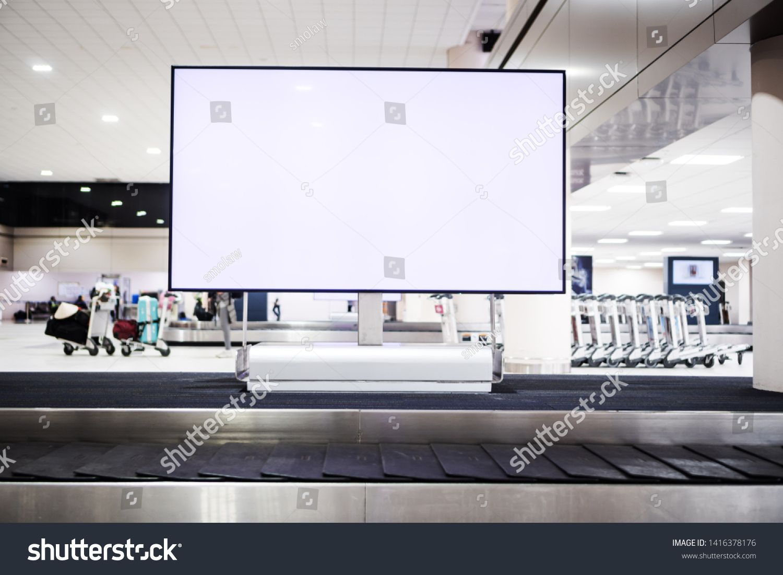 Blank advertising billboard at conveyor belt luggage in