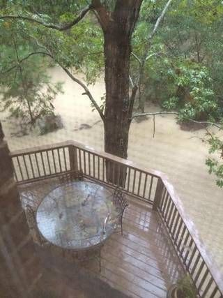 Rising water flooded yards like this in Kings Grant Oct. 4. Neighbors question whether a dam break at Fort Jackson was the primary reason.
