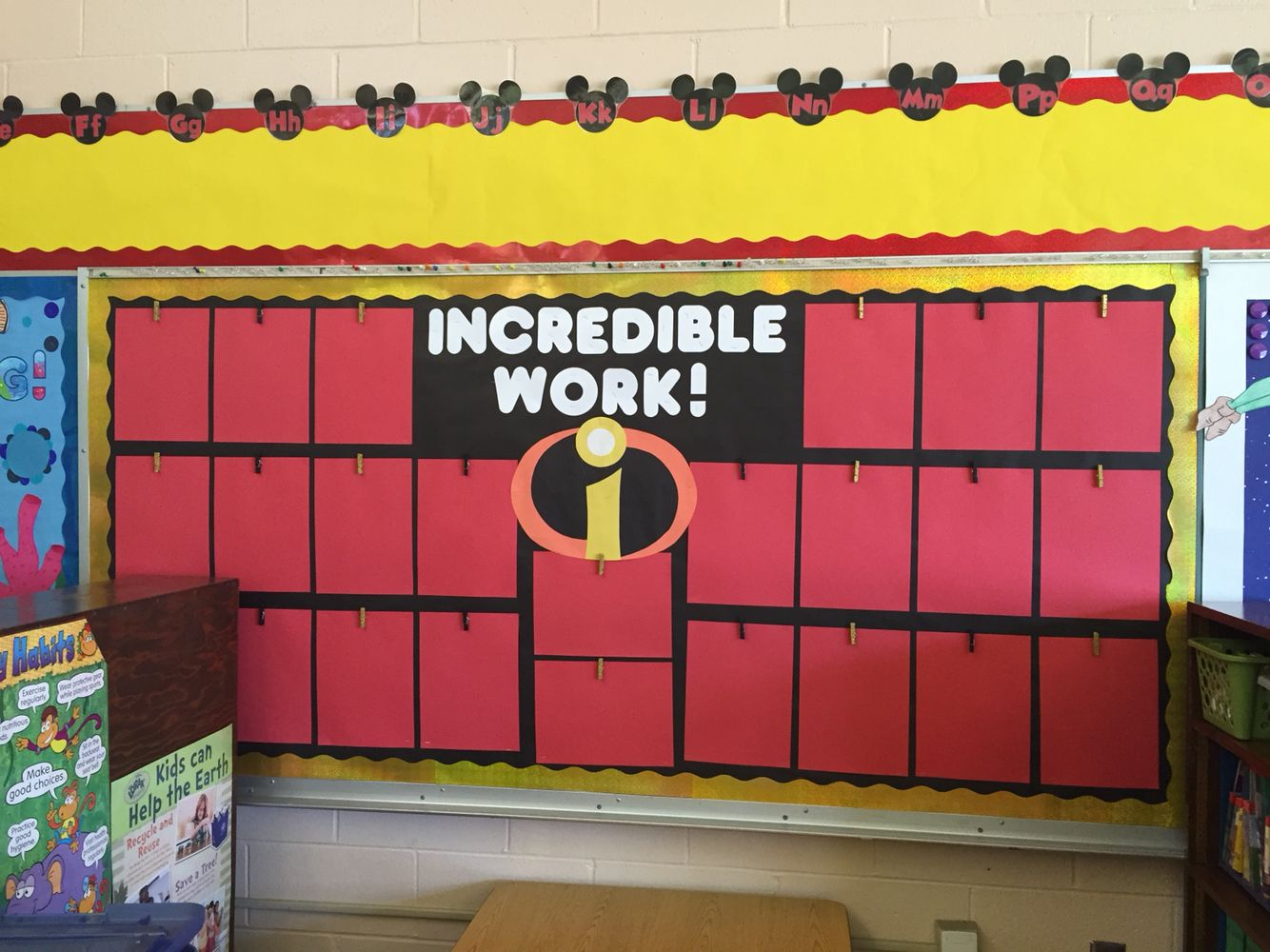 Classroom Decoration Word Work ~ Incredibles student work bulletin board disney word wall