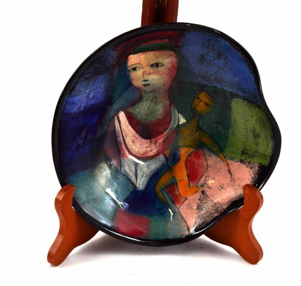 Featured is an original piece of art pottery by mid-century