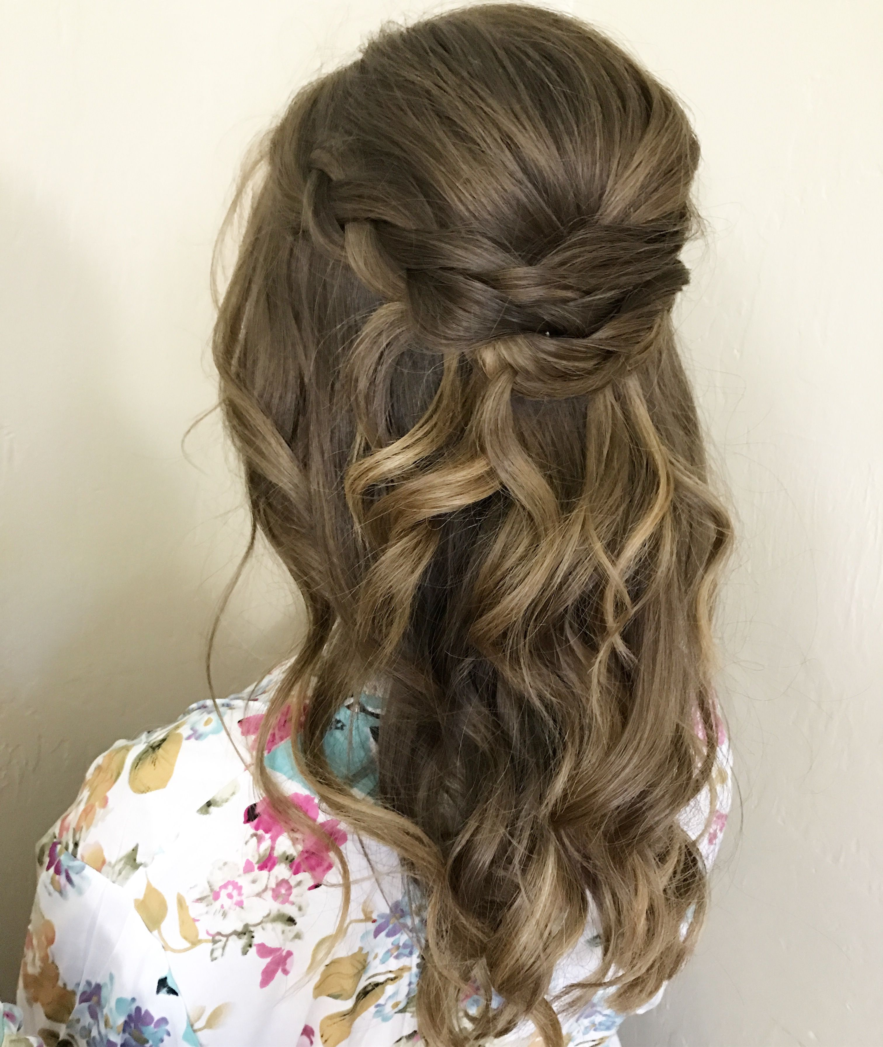 bridal or bridesmaids hairstyle half up half down loose curls