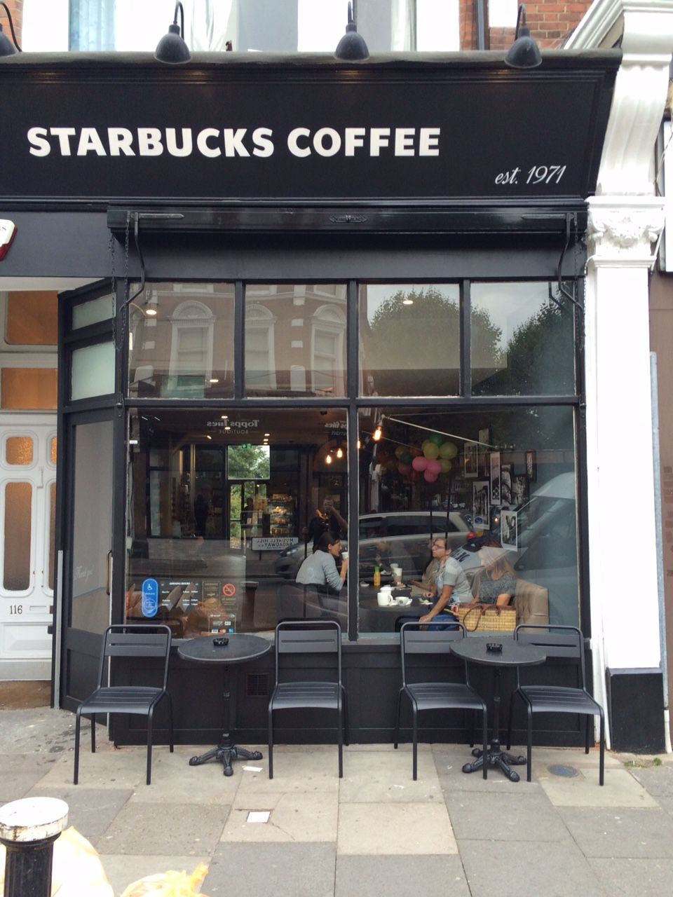 A Great Picture Of A Victorian Awning Retracted At Starbucks By