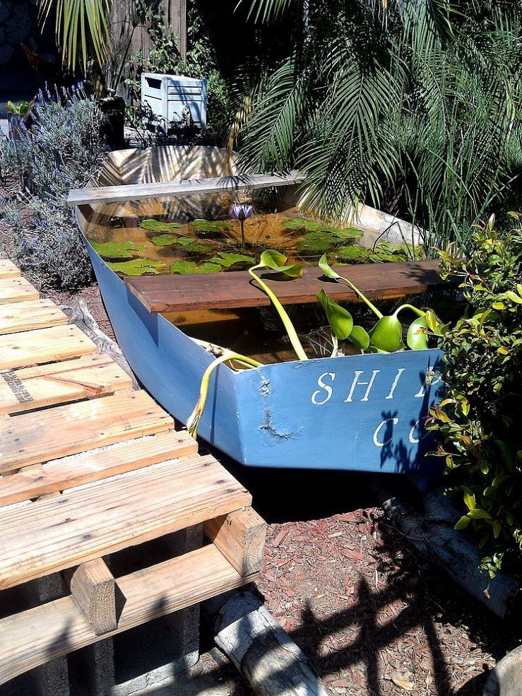 My shipwreck water lily pond gardens boats and boat dock for Pallet boat plans
