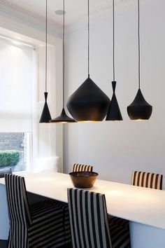 Lighting With Modern Sensibility In A Matte Finish Dining Room
