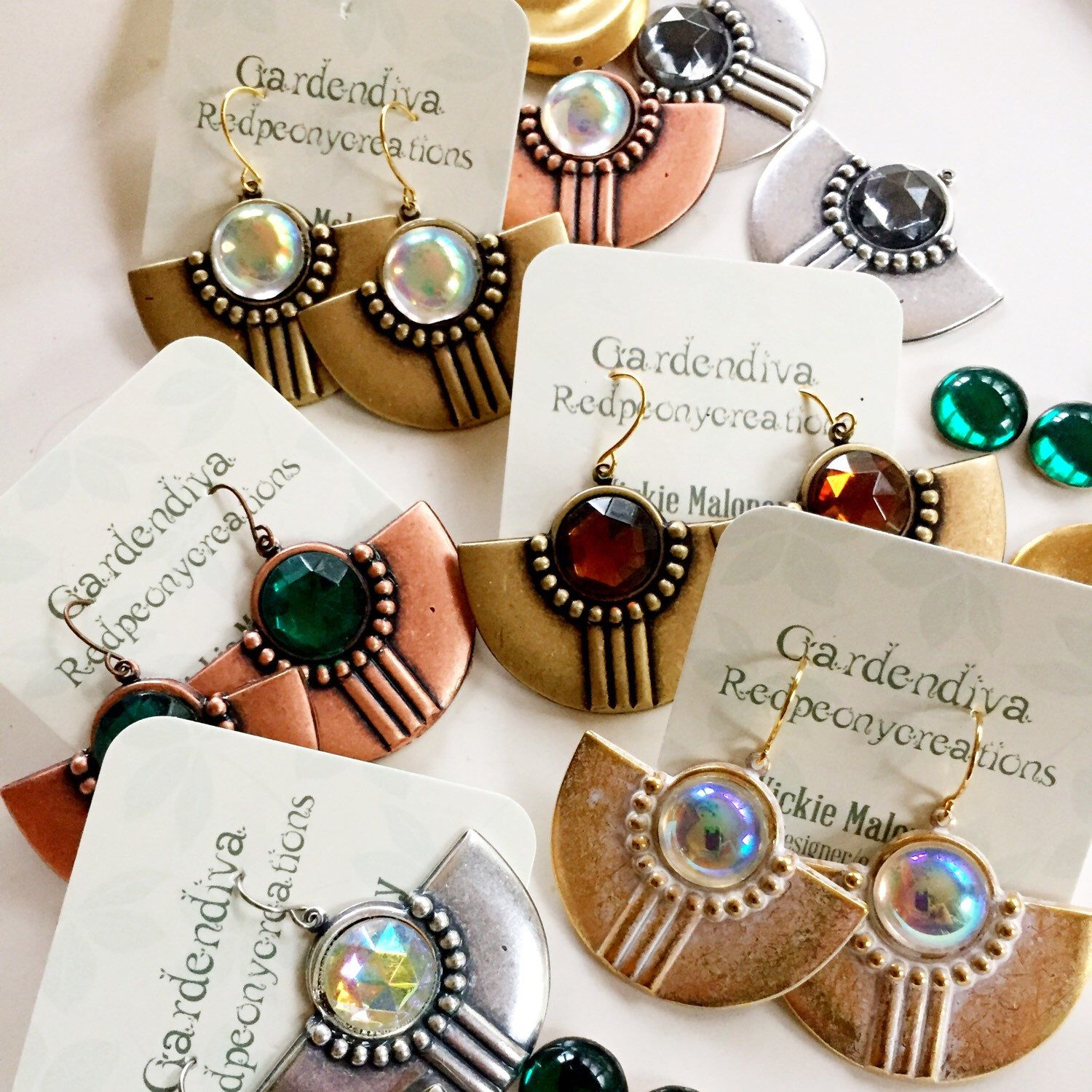 Love the new trendy, Art Deco Shield earrings that I'm adding to my shop!  The colorful Cabochons add sparkle to this Gatsby look!