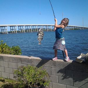 Treasure Coast Best Catch Photo Contest 1st Place Winner!   Photo by Stan Goswick  MY GRANDAUGHTER BAITS, CASTS AND BRINGS HOME DINNER