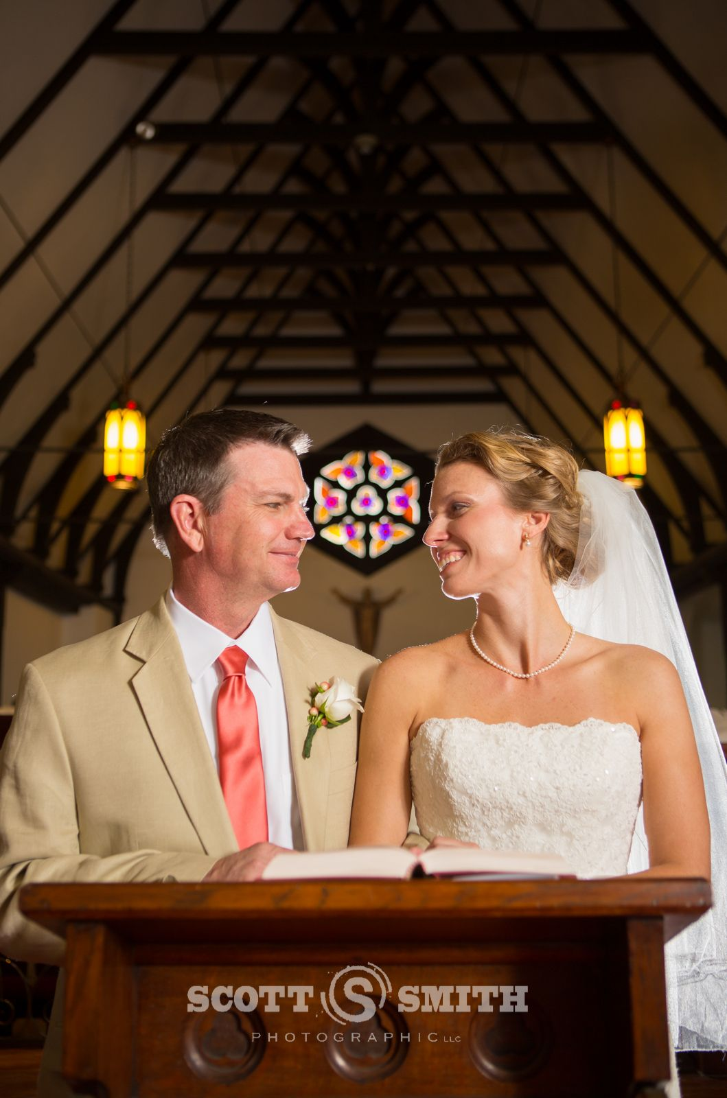 Couple in church knelling at the alter palatka florida