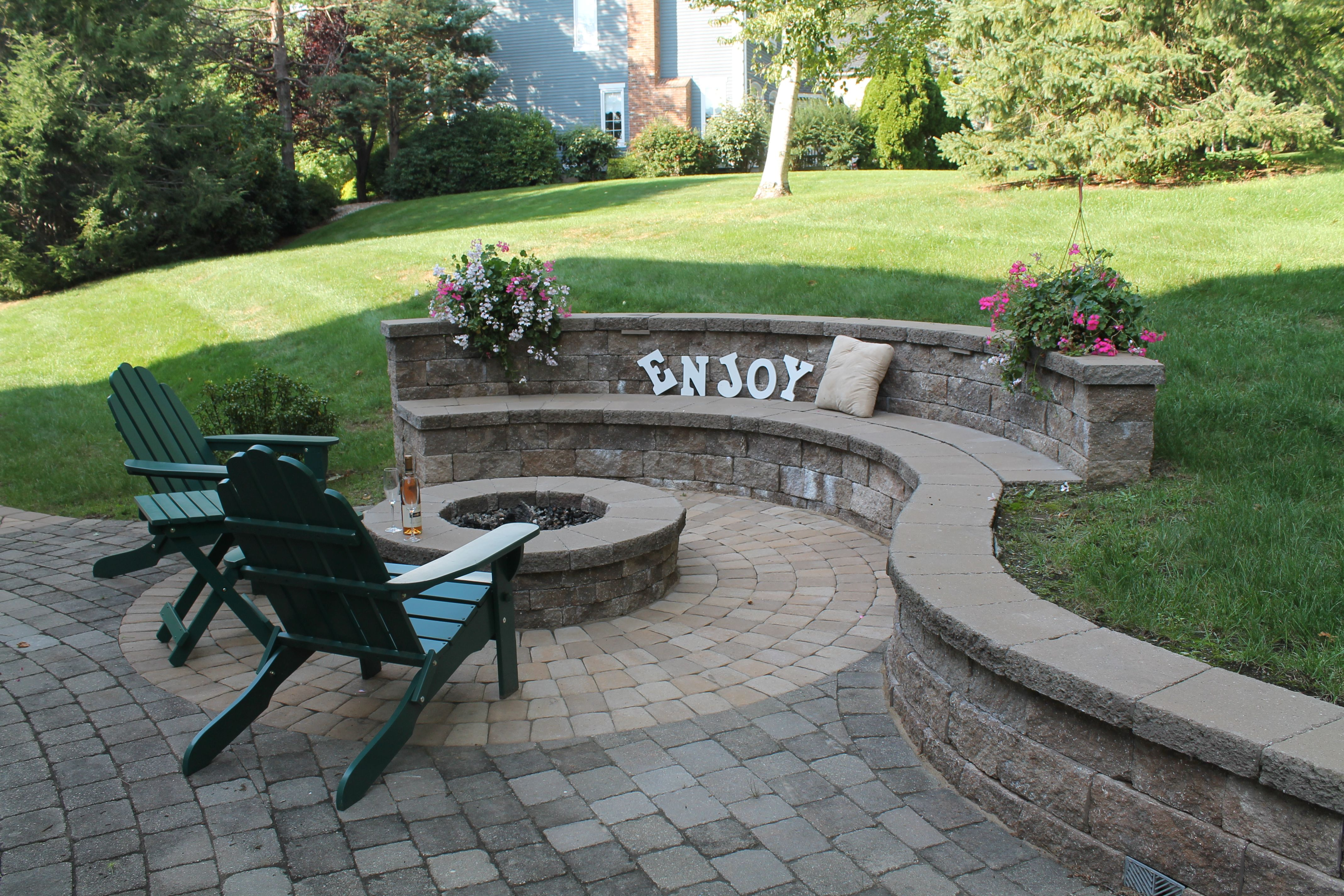 Paver patio with a techo bloc fire pit and built in for Patio and retaining wall ideas