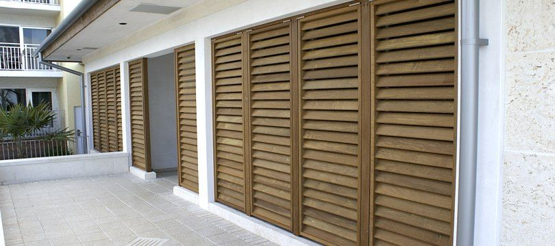 Exterior: Exterior Wood Bahama Shutters And