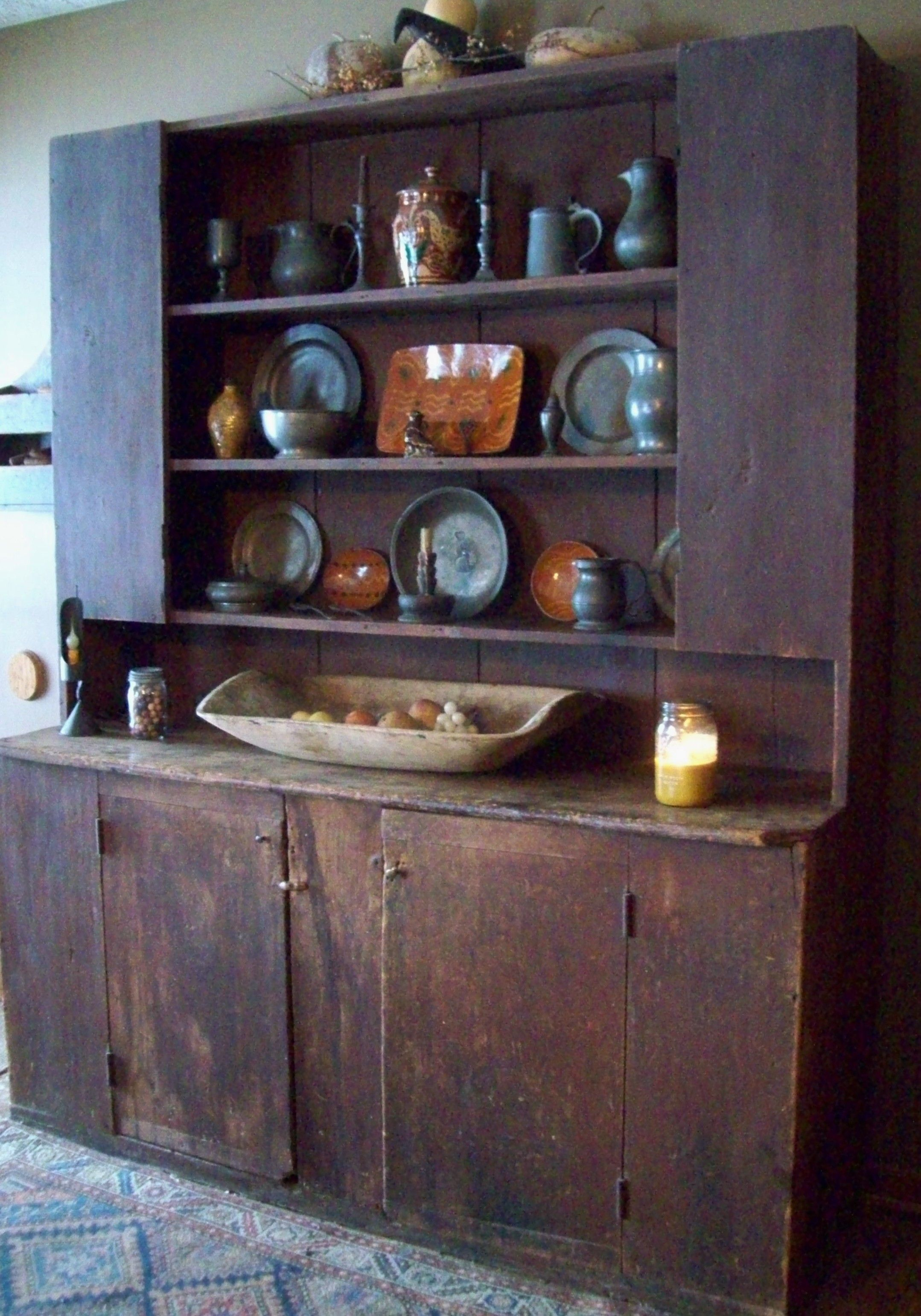 A beautiful primitive cupboard filled with pewter Love