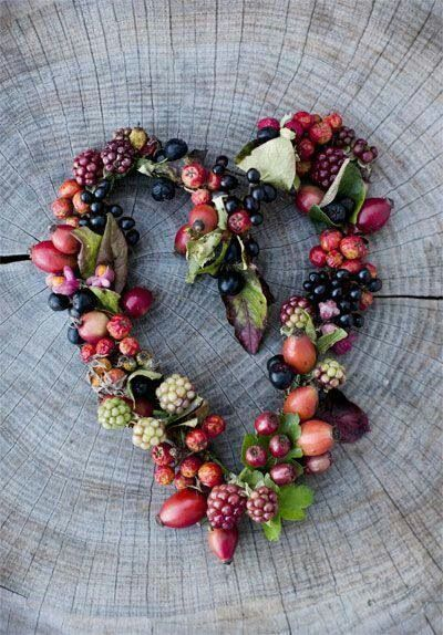 Autumn wreath with berries and flowers