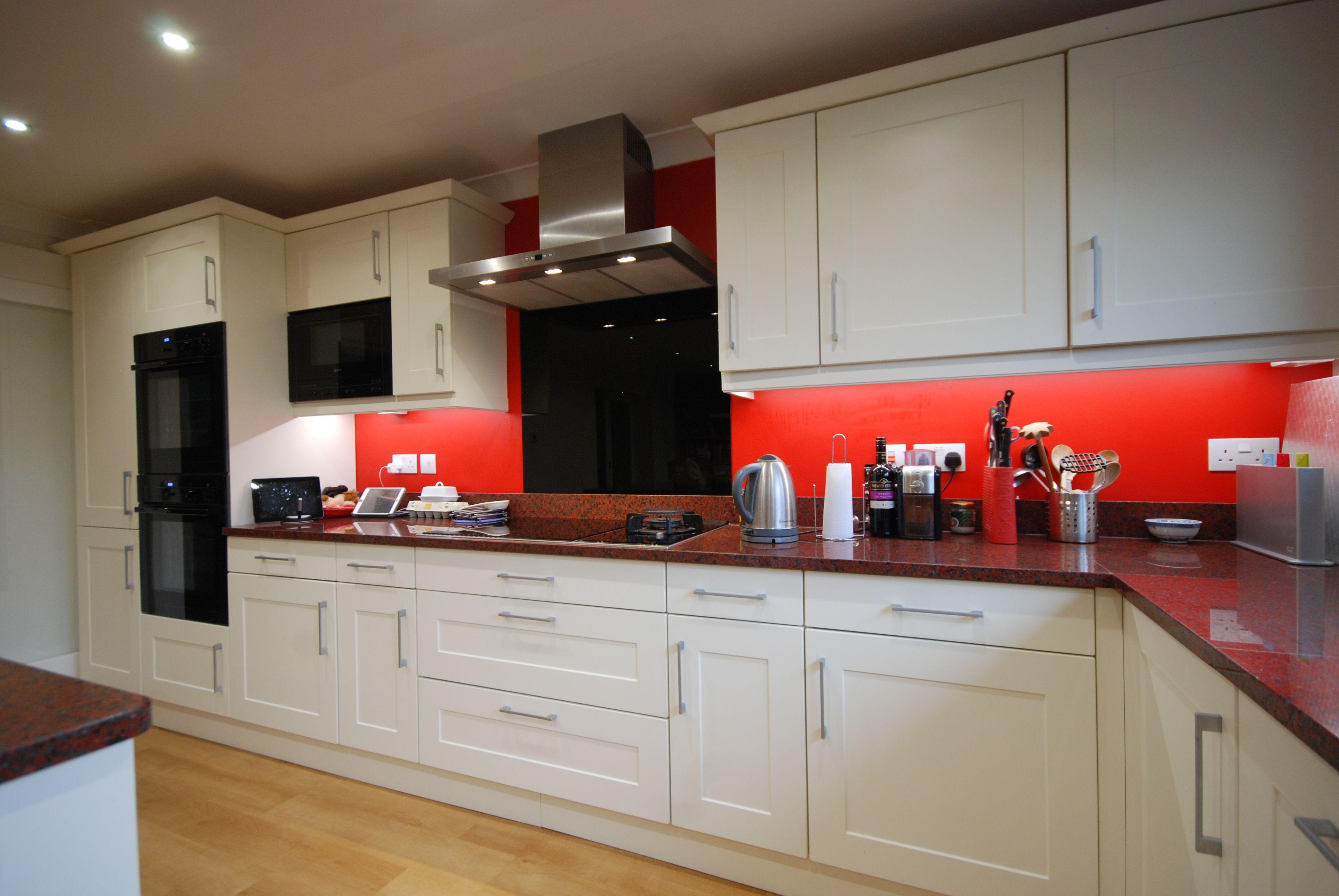Gairich Kitchen in Ivory with African Red Granite worktops Neff