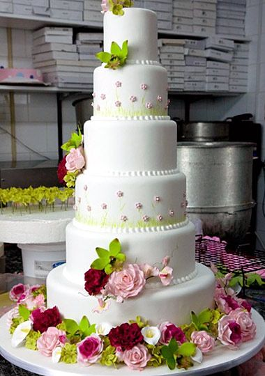 Cake Boss - Lovely and clean design.  Buddy's sugar flowers are unbelievable!