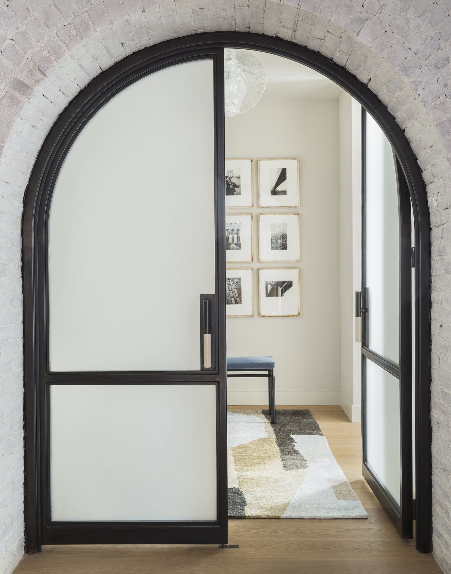 Arched Interior Doorway With Black Steel And Frosted Glass