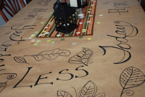 I like to use brown paper on the table instead of a tablecloth :-)  This is from my parent's anniversary.
