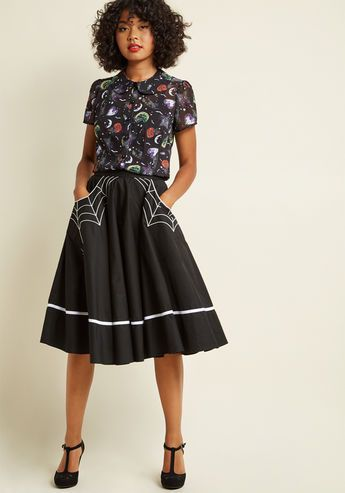 your style moods can change with the tides but your love for quirky choices like this black skirt is everlasting featuring white trim and pockets upon