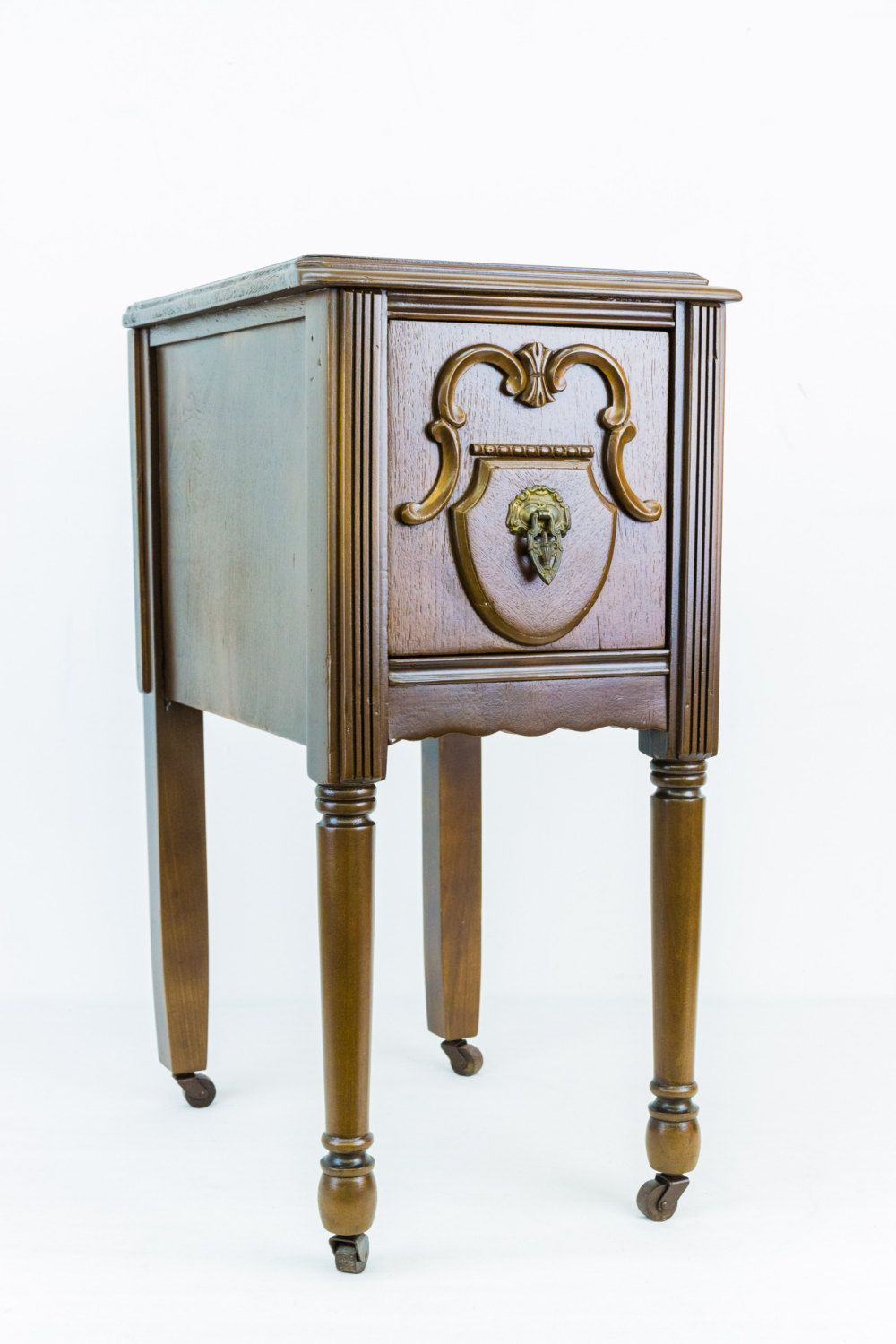 Restored wooden vanity side table with original wooden casters