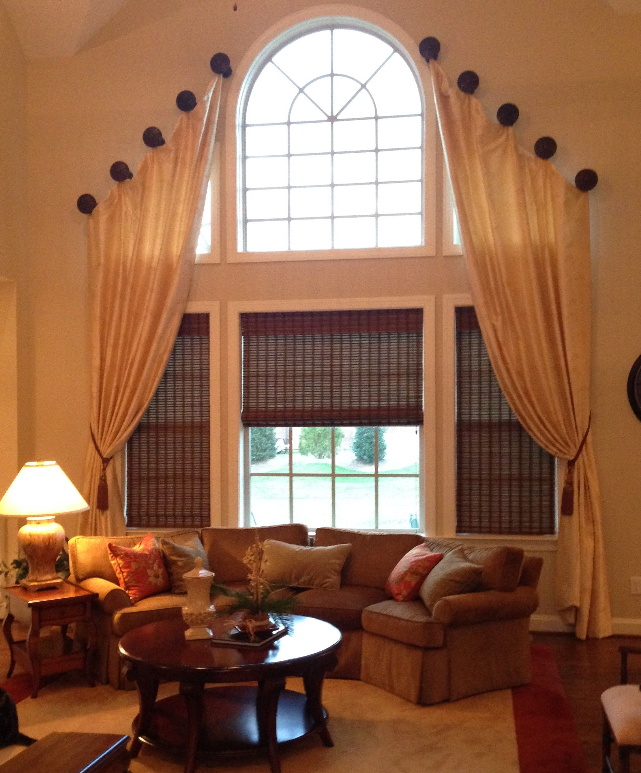 A Two Story Living Room Requires Dramatic Window Treatment Medallions Mounted Above Palladian Windows Support Elegant Silk Draperies