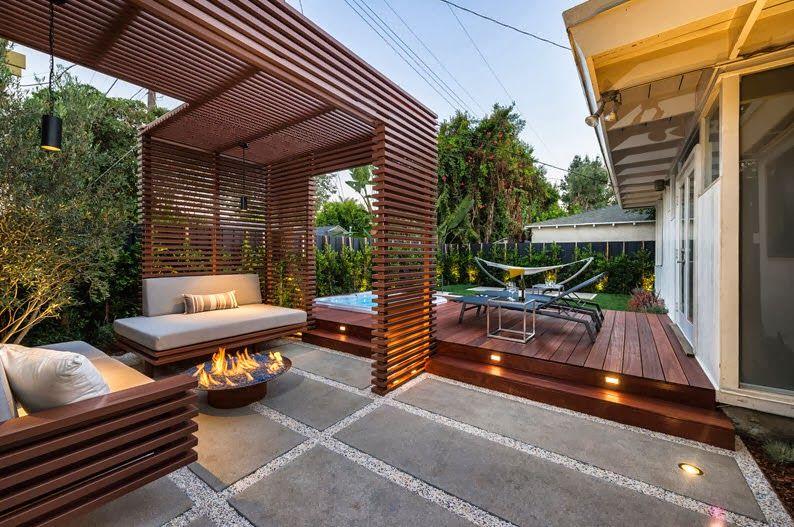 rea de descanso en patio seco con pergola de madera y