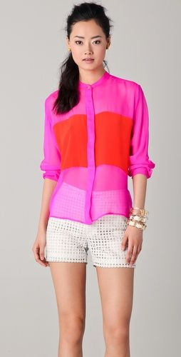 One by sheer color-block blouse- perfect for Cannes and all about color. $231.