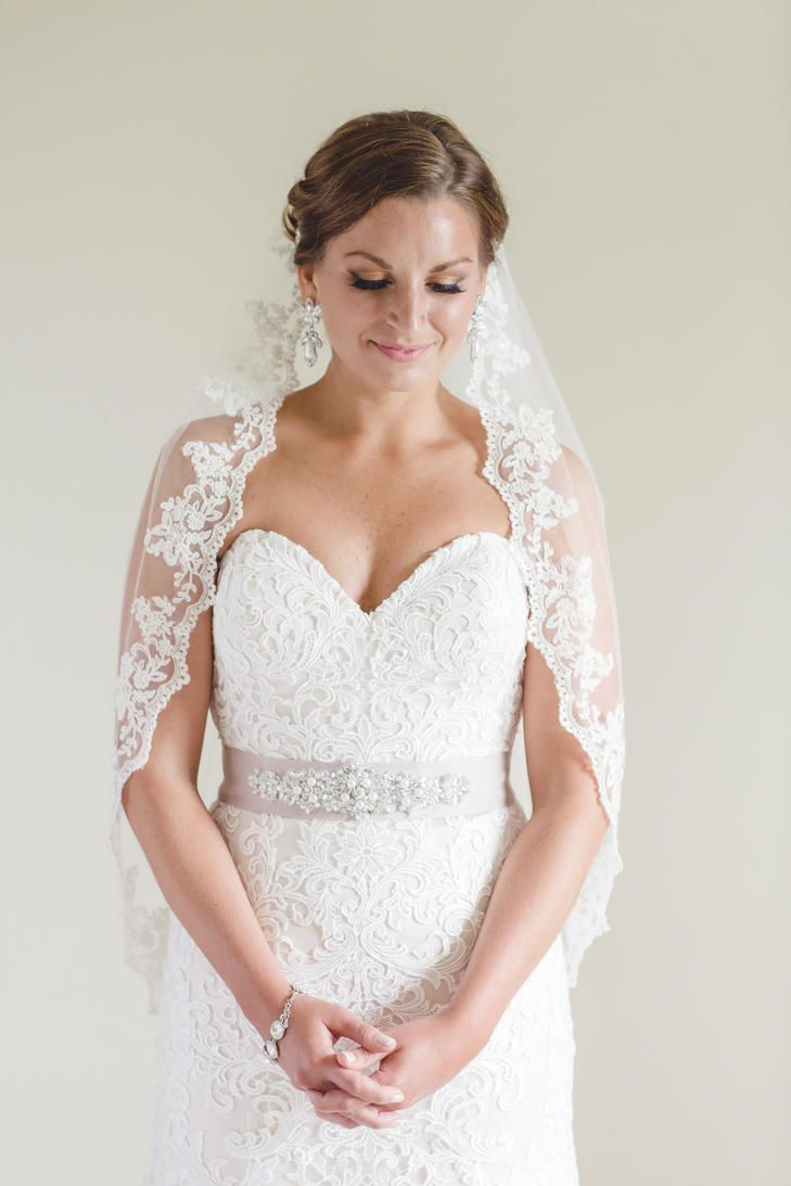 Sweetheart strapless lace gown was accessorized with a blush beaded ...