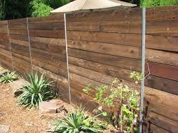 Steel & wood nice but fence too solid  PostMaster Steel