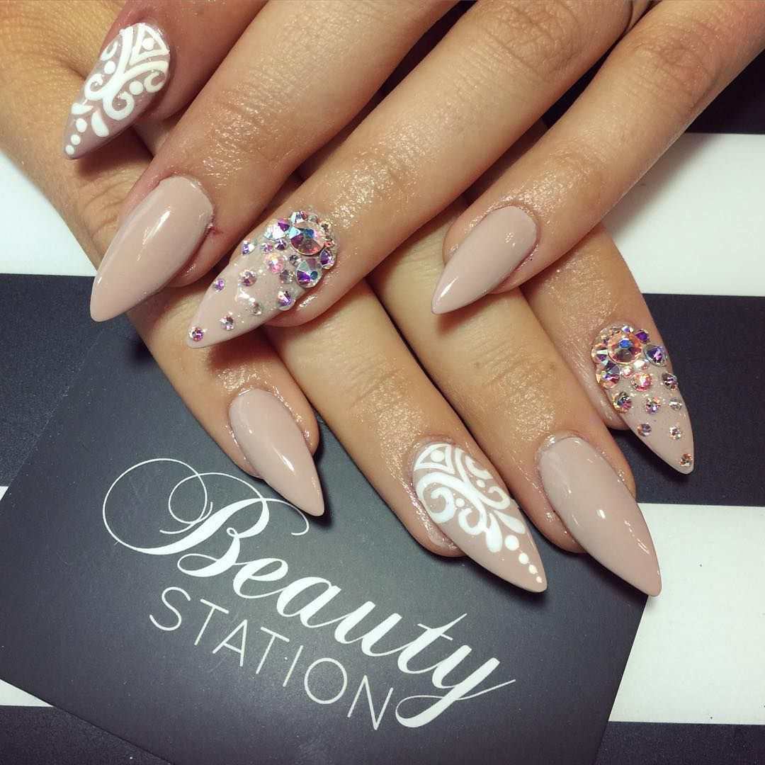 """ @gemita2614 #stiletto #swarovski #handpainted #Nails #nails2inspire"""