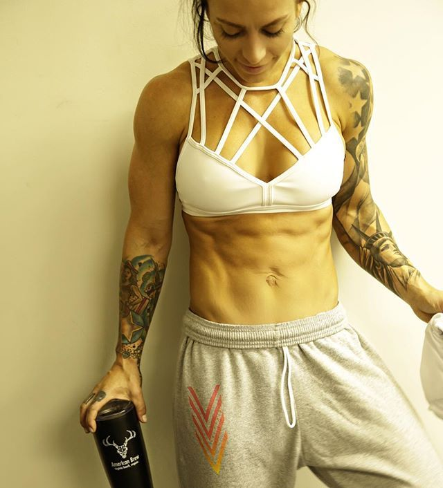 I am sooo excited about the @valkyrie.surf fall  line launching soon!  We have Or favorite boyfriend sweats coming back by popular demand and now available on my website is mg #CoffeeWhiskey @theamericanbrew thermals available  Perfect for the chilly mornings ahead. - Sports bra @reebok  Sweats @valkyrie.surf  Thermal @theamericanbrew  Abs #Crux