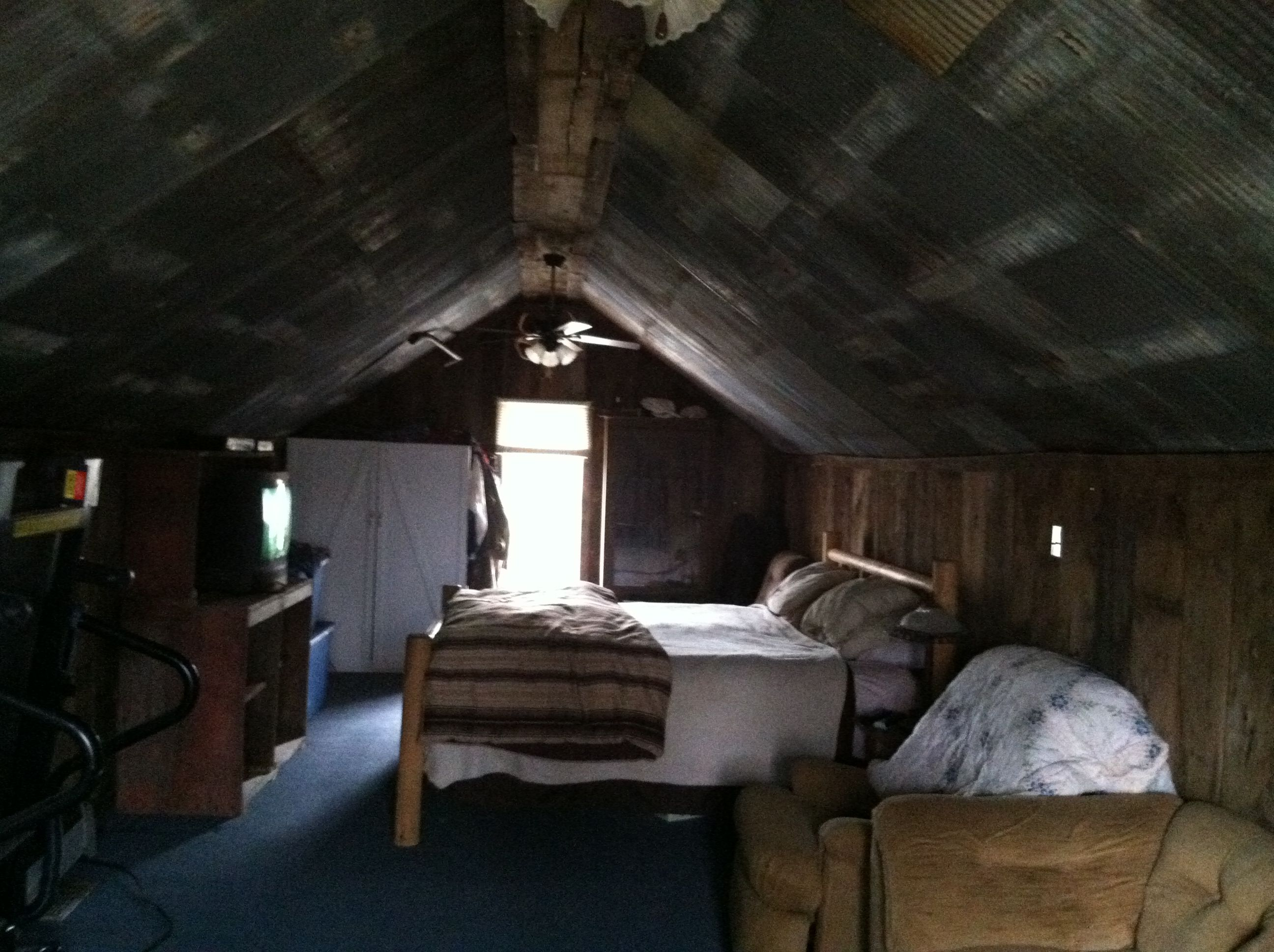 Attic bedroom old barn tin on the ceiling and barn wood for Old barn tin ideas