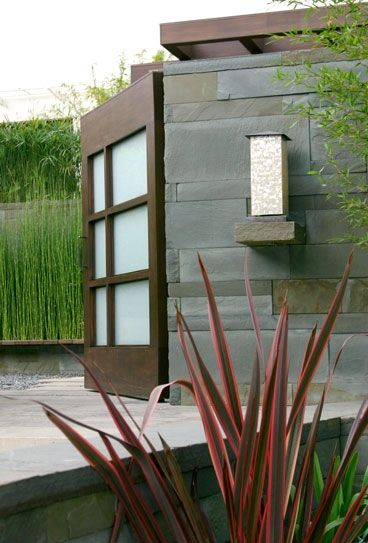 Gorgeous garden/house entry. Like the slate cladding.