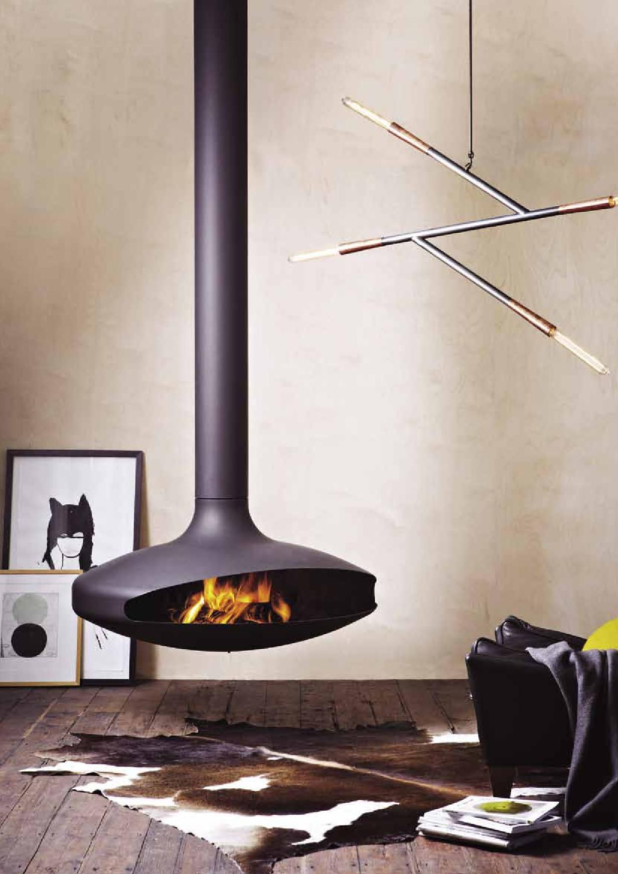 Gyro suspended fireplace by Oblica. Artwork by Emma Cleine of Lumiere Art &  Co and
