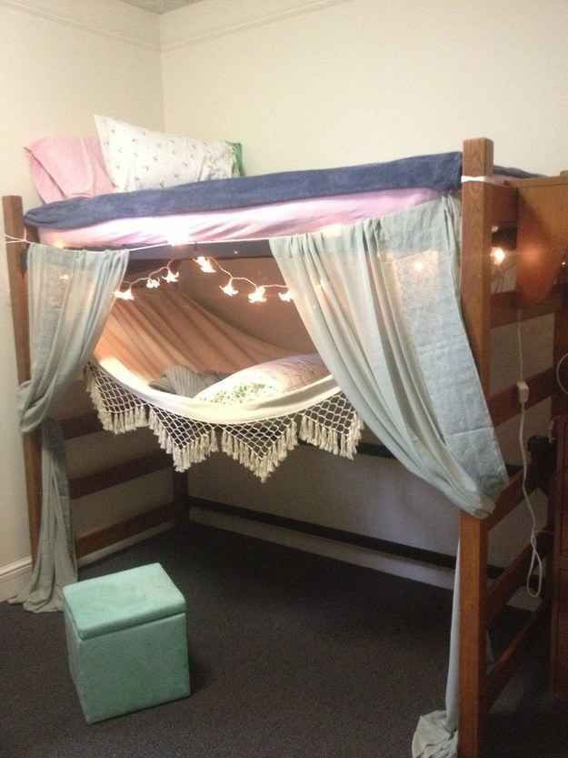 Make A Lofted Bed Fort Like With Starry Lights And A Tied On Curtain. | 37  Ingenious Ways To Make Your Dorm Room Feel Like Home