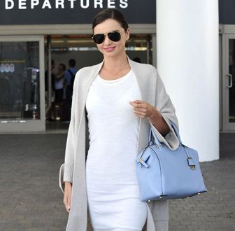Copy Miranda Kerr�s Oversized Cardigan, White Dress and Pastel Blue Bag For Chic Spring 2015 Airport Style