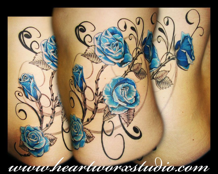 blue roses tatt on ribs
